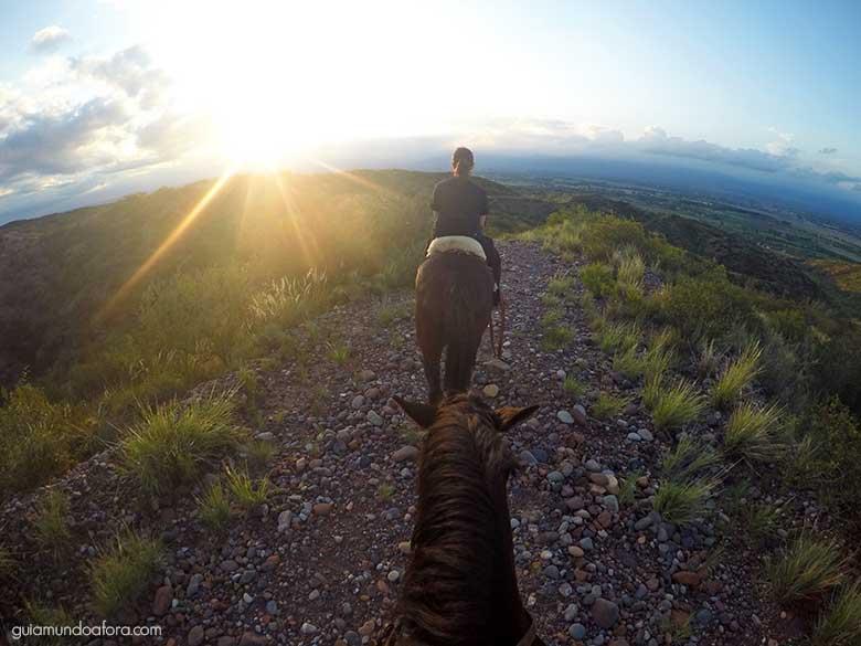 Por do sol em Cavalgada em Mendoza